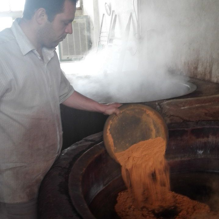 Dye Being Poured Into a Vat