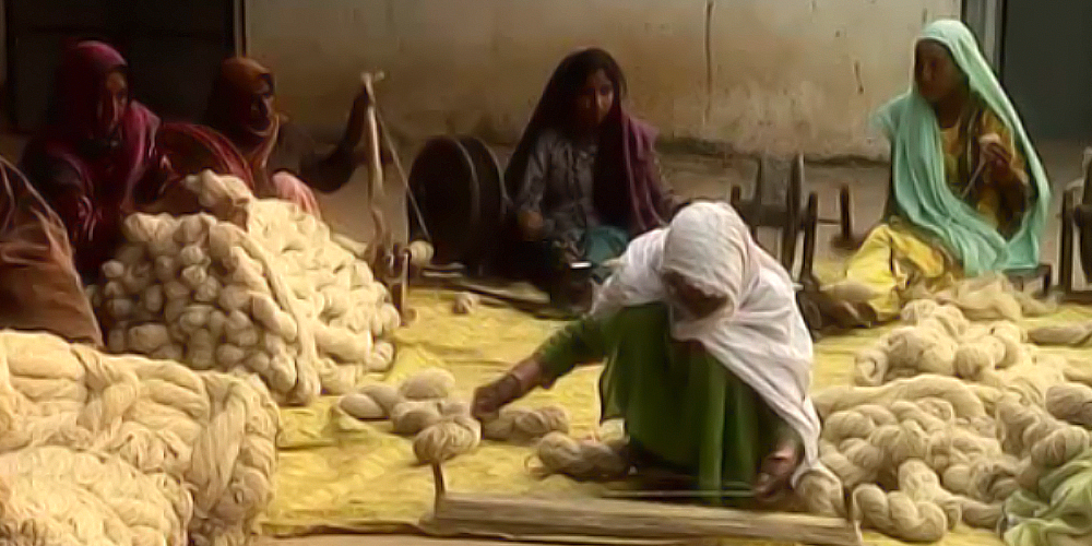 Women in India Spinning Yarn